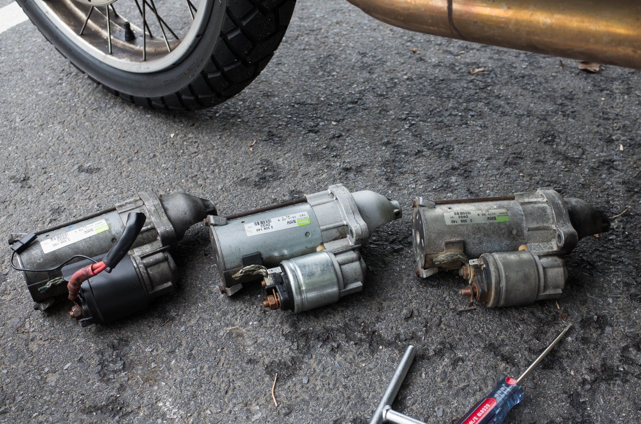 2005 BMW R1200GS Starter Motor Comparison. On the left is the Rev It Red used motor, the middle is the beautiful motowarrior replacement, and on the right is the dying one from my bike.